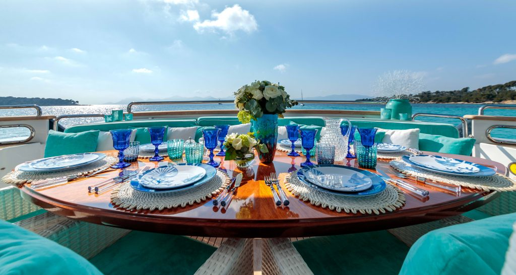 Luxury Interior Design of Yacht, beautifully set table on the bow of a yacht